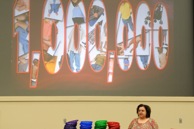 Stacey Haynes, the exceptional family member coordinator and a family advocacy speaker, talks to Soldiers about domestic violence during safety summer training May 17 at Haszard Auditorium. The training covered a total of seven topics.