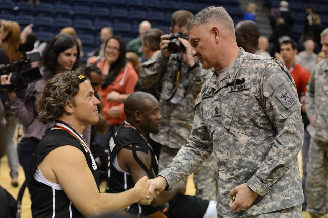 Sgt. Maj. of the Army Raymond Chandler presents James Green with a coin after Green won a gold medal in the wheelchair basketball finals with the Army team in the 2013 Warrior Games in Colorado Springs, Colo., May 15, 2013.