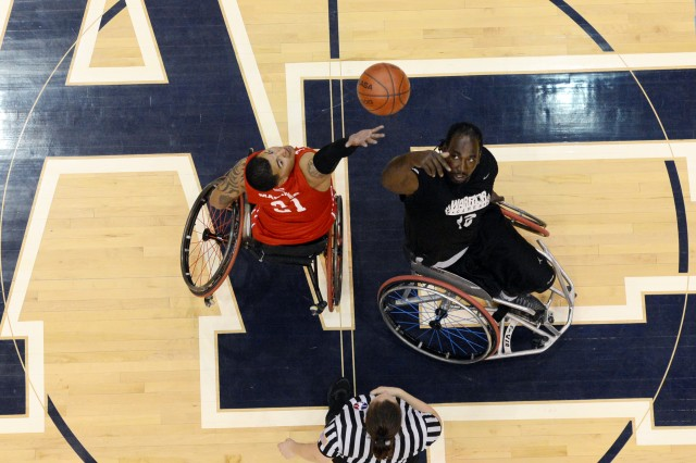Army's Anthony Pone (right) takes the tipoff from Marine Jorge Salazar during the gold medal wheelchair basketball match of the 2013 Warrior Games in Colorado Springs, Colo., May 15, 2013.