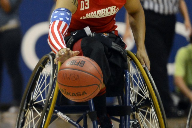 Marine veteran Cpl. Josue Barron breaks away during the gold medal wheelchair basketball match of the 2013 Warrior Games in Colorado Springs, Colo., May 15, 2013.