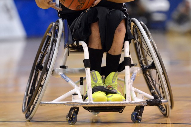 Scars show on Army team's point guard Juan Soto's legs and wheelchair during the gold medal wheelchair basketball match of the 2013 Warrior Games in Colorado Springs, Colo., May 15, 213. Soto won gold with his team beating the Marines.