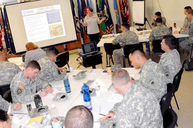 U.S. Agency for International Development Instructor Angela Shebenou presents a block of instruction on the Food for Peace, a program managed by her agency. Shebenou provided two days of instruction for Joint Humanitarian Operations course also known as JHOCs, May 14-15. Nearly 30 U.S. Army Africa Soldiers and civilians participated in the course.