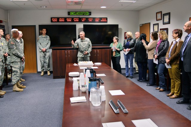 Brig. Gen. Mike Bills, U.S. Army Europe G-3, talks about the legacy of Command Sgt. Maj. Eric Cooke during a dedication ceremony of the CSM Cooke Conference Room in the Gen. Shalikashvili Mission Command Center on Wiesbaden's Clay Kaserne May 1.