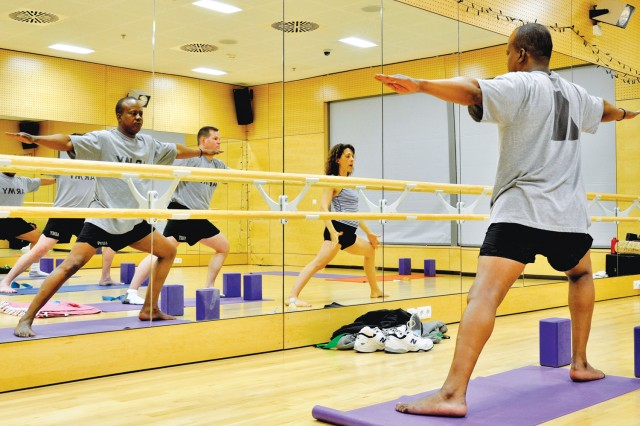 Warrior Transition Unit soldier Staff Sgt. Deneal Martin watches his yoga form in a mirror during a WTU yoga class at the Wiesbaden Fitness Center.