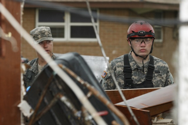 Members of the Oklahoma National Guard's 63rd Civil Support Team prepare to start search and rescue operations in response to the May 20, 2013, EF-5 tornado that ripped through the center of Moore, Okla.