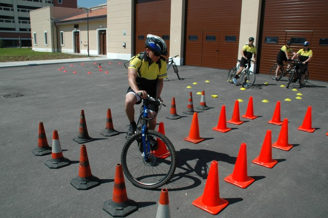 Military Police Soldiers receive bicycle training at Del Din to prepare for upcoming patrols at the new base May 14. Details of the training include obstacle courses, timed rides, night rides and quick dismounts.