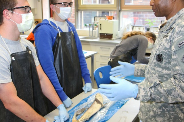 Lt. Gen. Thomas P. Bostick, the U.S. Army Corps of Engineers commanding general and 53rd chief of engineers, discusses the importance of science, technology, engineering and math, or STEM, with students in an Advanced Placement biology class May 14 during a visit to Patch High School in Stuttgart, Germany. The students were dissecting small sharks.