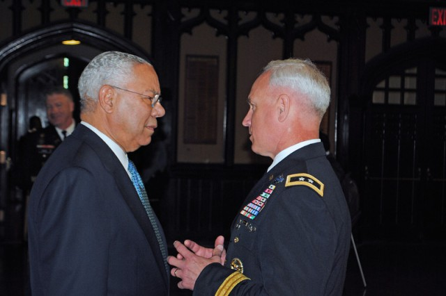 Retired Gen. Colin Powell (CCNY, 1958) chats with Maj. Gen. Jeff Smith (right), commander, U.S. Army Cadet Command and Fort Knox, Ky., after the ceremony, May 21, 2013, marking the return of Army ROTC to the City College of New York campus after more than 40 years.