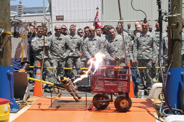 Sparks fly during a demonstration of what can happen when dealing with downed power lines. The Dominion Virginia Power demonstration crew and trailer provided a training demonstration at the Army Air Operations Group Safety Day at Davison Army Airfield, Tuesday.