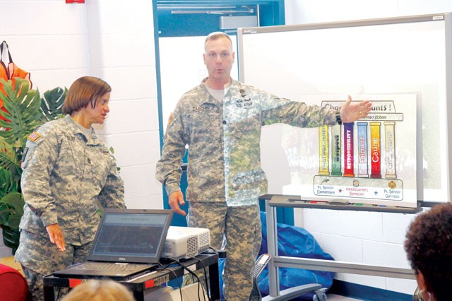 Fort Belvoir Headquarters Battalion Command Sgt. Maj. Carolyn Reynolds and Lt. Col. Brian Zarchin, commander, Hq. Bn., explain the post resiliency program to the Fort Belvoir Elementary Parent Teacher Organization (PTO), at the Fort Belvoir Elementary School May 9.