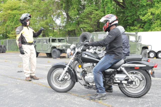 Patrick Gallagher, Motorcycle Safety Course lead instructor, instructs Basic Rider Course participants on how to properly start their motorcycles during training May 13, at Fort Belvoir's motorcycle training range. Gallagher's instruction was part of a two day course where six participants learned the basic fundamentals of safely riding a motorcycle.