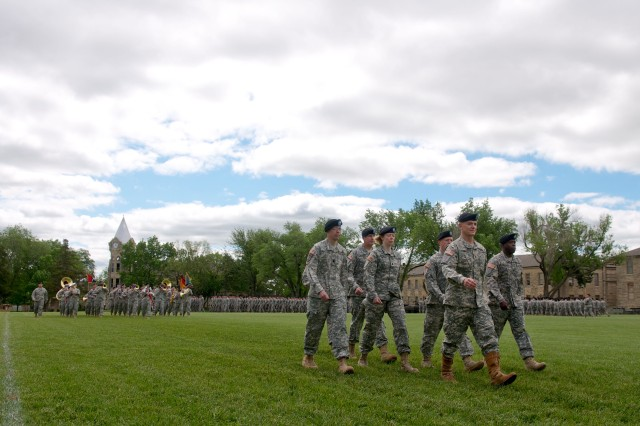 New 1st Infantry Division Commander Maj. Gen. Paul E. Funk II leads his troops during the Pass in Review at the end of the division's change of command ceremony May 22 on Fort Riley's Cavalry Parade Field. Funk accepted command of the Army's oldest division from Maj. Gen. William C. Mayville, Jr., during the ceremony.