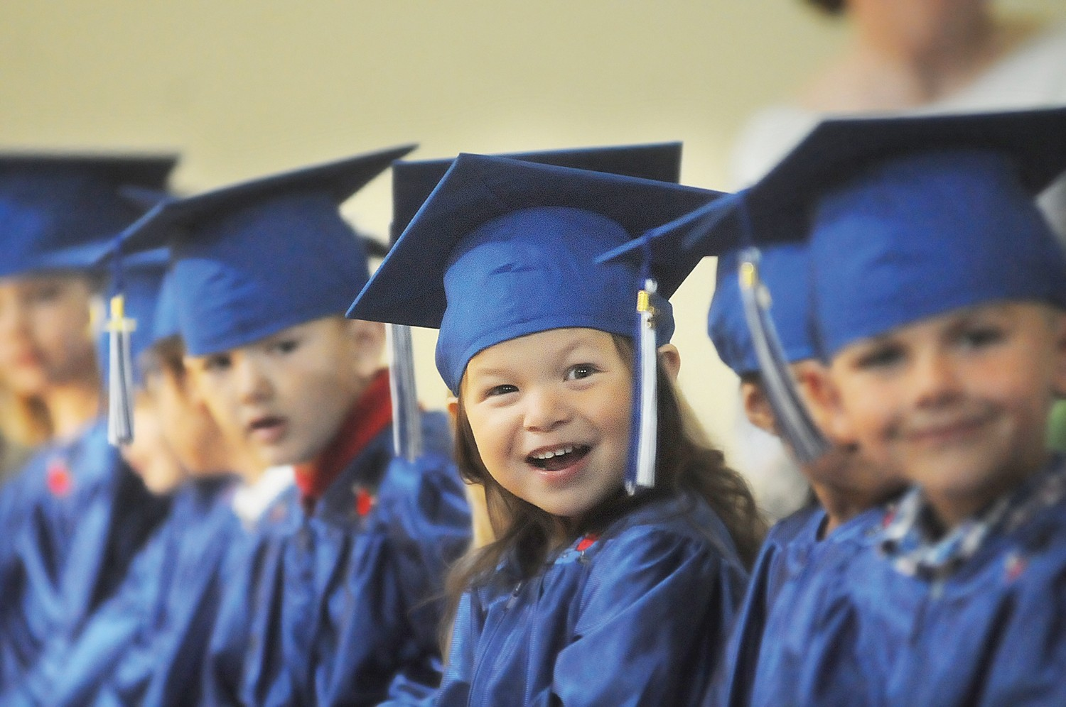 Happy first steps: pre-kindergarten students don cap, gowns for ...