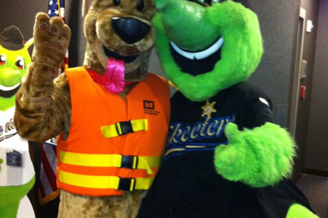 "SUGAR LAND, Texas (May 18, 2013) - USACE Galveston District staff hand out water safety and hurricane preparedness information during a Sugar Land Skeeters Minor League Baseball game to ""Strike Out Drowning"" during ""Emergency Responders Night."" Hurricane season begins June 1. In the photo, Corps Water Safety Mascot Bobber the Water Safety Dog stands tall with Moe Sketter, Sugar Land Skeeters mascot, prior to the start of the game. Visit http://www.swg.usace.army.mil/BusinessWithUs/PublicAffairsOffice/WaterSafetyProgram.aspx to learn more about the district's water safety program."