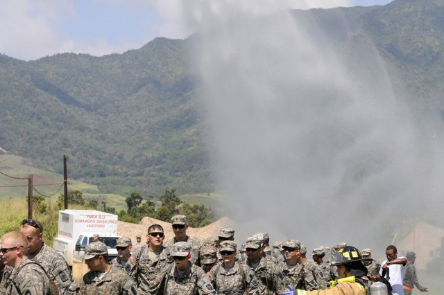 The Federal Fire Department uses a fire truck to conduct a hasty mass casualty decontamination on over 60 role-playing victims during joint training with the 8th Military Police Brigade.  FFD was amongst the first responders on scene during a mass casualty decontamination portion of a two-day exercise put on by the 8th MP Bde., April 25.