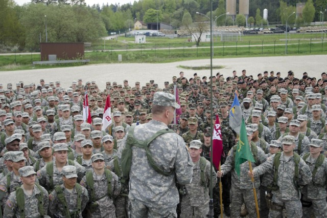 Col. David Woods, a Denbo, Pa. native and the commander of the 525th Battlefield Surveillance Brigade, who will be taking command of Multinational Battle Group-East in Kosovo, addresses his troops during a battle group formation at the Joint Multinational Readiness Center in Hohenfels, Germany May 6. The troops are conducting a three-week long training exercise in preparation for their upcoming deployment to Kosovo in support of NATO. 