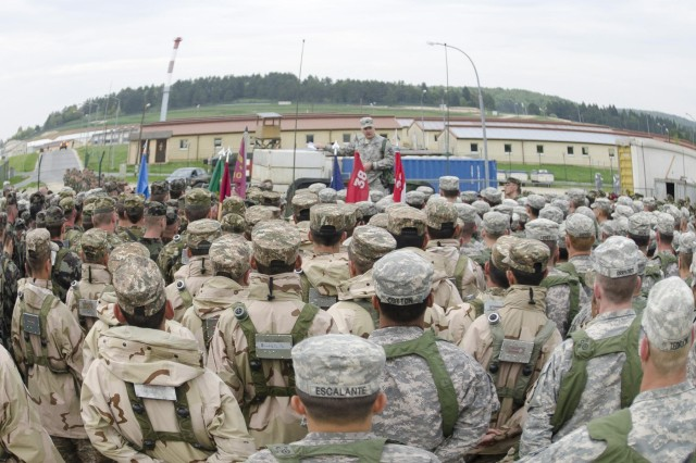 Multinational troops listen as the 525th Battlefield Surveillance Brigade Commander, Col. David Woods from Denbo, Pa., addresses the battle group at the Joint Multinational Readiness Center in Hohenfels, Germany May 6. Troops are finishing a three-week long training exercise in preparation for their deployment to Kosovo. 