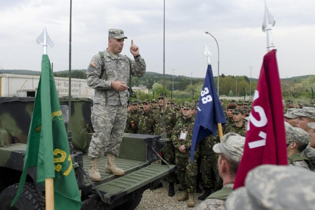 Col. David Woods, a Denbo, Pa., native and the commander of the 525th Battlefield Surveillance Brigade, who will be taking command of Multinational Battle Group-East in Kosovo, addresses his troops during a battle group formation at the Joint Multinational Readiness Center in Hohenfels, Germany May 6. The troops are conducting a three-week long training exercise in preparation for their upcoming deployment to Kosovo in support of NATO. 