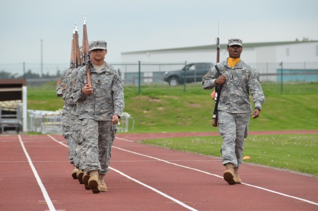 The Ansbach High School JROTC drill team marches in step during their battalion's change of command May 16.