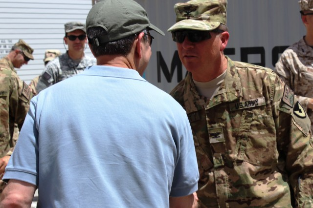 Col. Mark A. Paget, 401st Army Field Support Brigade commander greets the Honorable Alan F. Estevez, Assistant Secretary of Defense for Logistics & Materiel Readiness during visit on May 20. (Photo by Sharonda Pearson, 401st AFSB Public Affairs)
