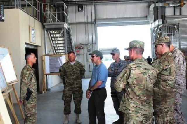 1st Lt. Douglas Windel briefs the Honorable Alan F. Estevez, Assistant Secretary of Defense for Logistics & Materiel Readiness, and other Department of Defense logistics leaders on the current retrograde process during May 20 visit.
