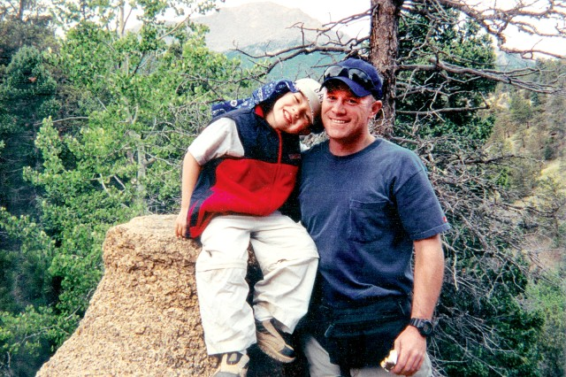 Sullivan and his son Nathan, then age 5, hike Pikes Peak together in Colorado the year before Sullivan deployed to Kuwait in support of Operation Iraqi Freedom.