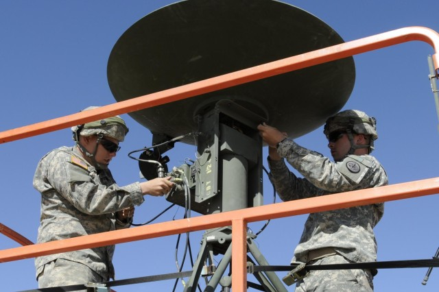 Pfc. Mathew Green, a native of Rogers, Ark., and Pvt. Aaron Grumm, of Sierra Vista, Ariz., both unmanned aerial vehicle operators, from the 66th Military Intelligence Company, 3rd Squadron, 3rd Armored Cavalry Regiment, based at Fort Hood, Texas, put together the ground data terminal antenna on top of a scissor lift, May 25, 2013. The GDTA provides data links between the ground control station and aerial vehicles. UAVs perform reconnaissance and even carry out attack missions from high above the battlefield.