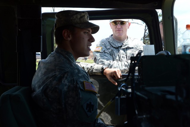 Spc. James Kimball, Headquarters and Headquarters Company conveys to Chaplain Capt. David Jordan, Company A, 1st Battalion, 279th Infantry Battalion, on May 22, 2013, that he grew up in the tornado torn area of Moore, Okla., and is saddened by the results of the events. An Enhanced Fujita Scale 5 tornado 1.3 miles wide tore through central Oklahoma leaving a 17-mile long path of destruction in its wake May 20, 2013.