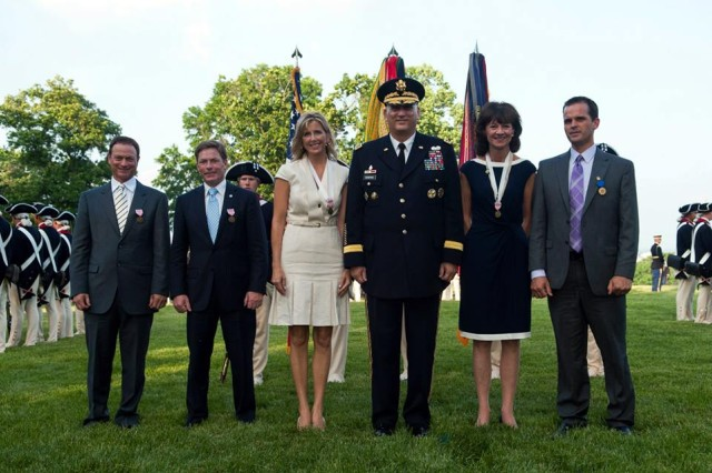 From left, Gary Sinise, Kenneth Fisher, Kathleen Gagg, Army Chief of Staff Gen. Ray Odierno, Deborah Tymon and Ryan Blanck pose for a photograph during the Twilight Tattoo Salute at Whipple Field in Joint Base Myer-Henderson Hall, Va., May 22, 2013. Odierno presented the honorees with the Outstanding Civilian Service Medal. (U.S. Army photo by Staff Sgt. Teddy Wade/ Released)