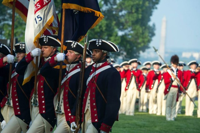 """U.S. Army Soldiers from the 3rd Infantry Regiment """"The Old Guard"""" perform during the Twilight Tattoo Salute at Joint Base Myer-Henderson Hall, Va., May 22, 2013. (U.S. Army photo by Staff Sgt. Teddy Wade/ Released)"""