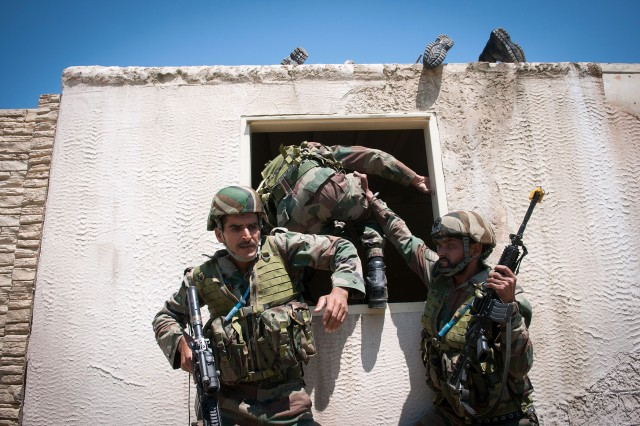 Indian Army paratroopers with the 50th Independent Para Brigade climb through the window of an mock insurgent compound during a company-level field exercise with U.S. Army paratroopers of the 82nd Airborne Division's 1st Brigade Combat Team May 14, 2013, at Fort Bragg, N.C.  The training is part of Yudh Abhyas, annual bilateral training between the Indian Army and United States Army Pacific, hosted this year by the XVIII Airborne Corps at Fort Bragg.  (U.S. Army photo by Sgt. Michael J. MacLeod)