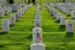 Old Guard Soldiers places flags at Arlington Cemetery