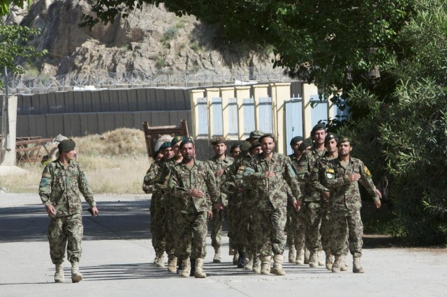 An Afghan National Army noncommissioned officer marches Afghan National Army soldiers as they conduct drill and ceremonies at Forward Operating Base Naghlu Riverside, April 30, 2013. U.S. Army Soldiers assigned to Security Force Assistance Advisory Team 15, advise ANA soldiers of the 4th Kandak, 3rd Brigade, 201st Corps on field artillery, logistics, reconnaissance, engineering and other operations. (U.S. Army photo by Staff Sgt. Richard Andrade, Task Force Long Knife Public Affairs)