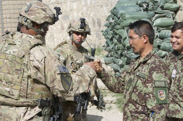 U.S. Army Maj. Demetrius Perry, (left), a native of Houston, Texas, bumps fists with Afghan National Army Maj. Mohammad Hussin, executive officer of the 4th Kandak (battalion), 3rd Brigade, 201st Corps, after a meeting at Forward Operating Base Naghlu Riverside, April 30, 2013. He advises ANA soldiers on logistics, field artillery, reconnaissance, engineering and other operations. Perry is assigned to Security Force Assistance Advisory Team 15, 4th Brigade Combat Team, 1st Cavalry Division, based out of Fort Hood, Texas. (U.S. Army photo by Staff Sgt. Richard Andrade, Task Force Long Knife Public Affairs)