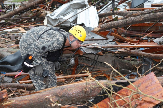 Sgt. Warren Williams, with the Oklahoma National Guard's 63rd Civil Support Team, searches debris in Moore, Okla., in response to the May 20, 2013, EF-5 tornado that struck the town, killing dozens of people.
