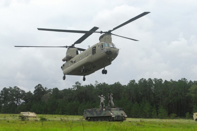 The CH-47 Chinook helicopter will be getting upgrades for its F and G models under the proposed fiscal year 2014 Army Equipment Modernization Plan and the Armored Multi-Purpose Vehicle is replacing the Vietnam-era M113 armored personnel carrier in phases. Shown here, Soldiers from the 8th Cavalry Regiment, 4th Infantry Brigade Combat Team, 3rd Infantry Division, slingload an M113 to a CH-47 helicopter recently at Fort Stewart, Ga.