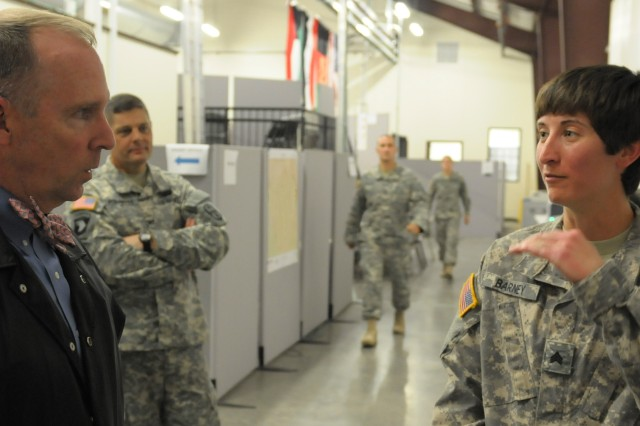 Visiting Ohio Congressman Mike Turner (left), role-played by Philip D. Calahan, First Army Division West's deputy director of operations, listens to Sgt. Angela M. Barney, an intelligence analyst with the Ohio National Guard's 371st Sustainment Brigade out of Springfield, Ohio. Role-playing scenarios while exercising at North Fort Hood, Texas, provide Soldiers with the experience of meeting public figures who may visit during the 371st's deployment to Kuwait. (Photo by Michael M. Novogradac, Division West Public Affairs)