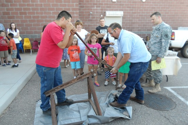 Colonel Johnston Families watch a geode-breaking demonstration at Science, Technology, Engineering & Math, or STEM Night. The event took place April 30.