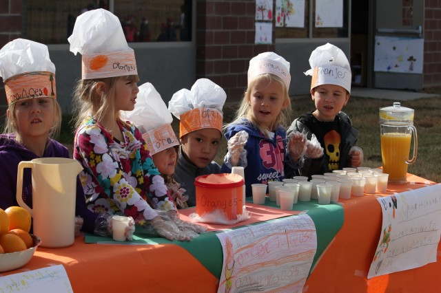 Kindergarten students in Colonel Johnston Elementary participate in a farmer's market, which took place last fall as a learning project to help younger children understand farming and where their food comes from. The youth raised $182 from selling student-prepared items at the event.