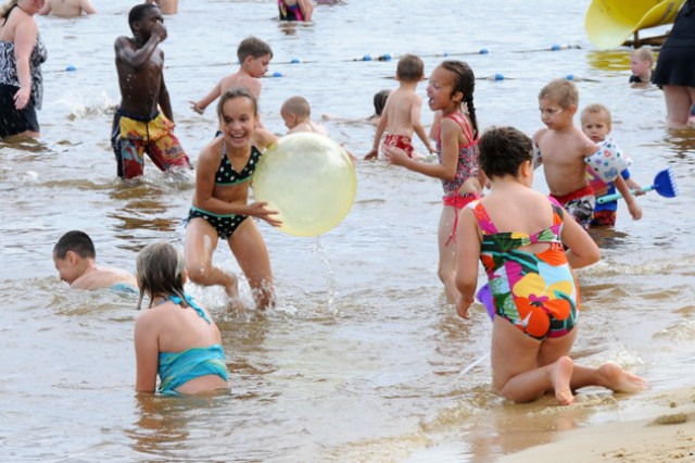 Children play in the enclosed swimming area at West Beach during Lake Fest May 18. Thousands of people came out to Lake Tholocco despite a rainy start to enjoy fun in the sun.