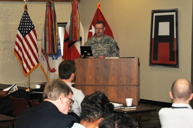 Maj. Gen. Kendall Penn, First Army deputy commanding general, provides opening remarks and welcomes Quad City area religious leaders to the 'Building Bridges for Resiliency' event held at the Rock Island Arsenal May 23.