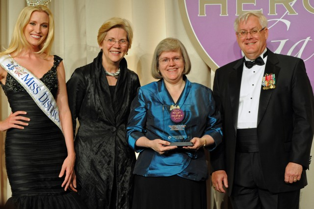 Hollister K. Petraeus (in blue) was awarded the PenFed Foundation Community Hero Award at the 9th Annual Night of Heroes Gala held at the Ritz-Carlton Hotel in Washington, D.C., May 23, 2013. Making the presentation from left to right Miss District of Columbia Allyn Rose, Massachusetts Sen. Elizabeth Warren and PenFed Foundation Chairman Bill Siegert.