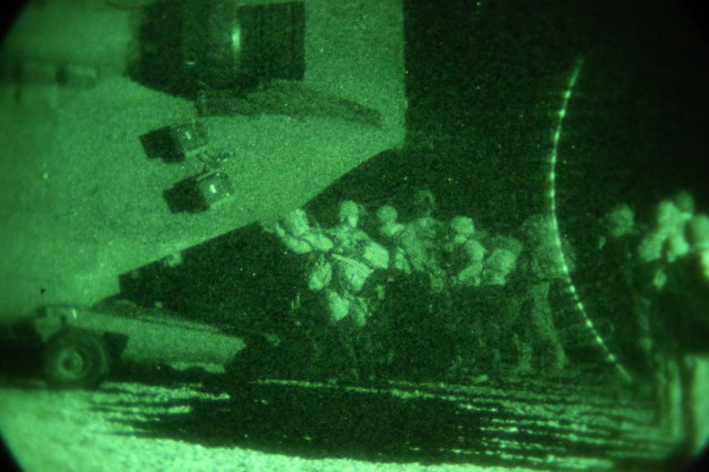 Soldiers of Alpha Company, 1st Battalion, 327th Infantry Regiment, 1st Brigade Combat Team, 101st Airborne Division (Air Assault), board a CH-47 Chinook during a night air assault operation from Forward Operating Base Connolly, Nangarhar Province, Afghanistan, May 14, 2013. Soldiers use Chinooks and the cover of darkness to safely move to their area of operation.