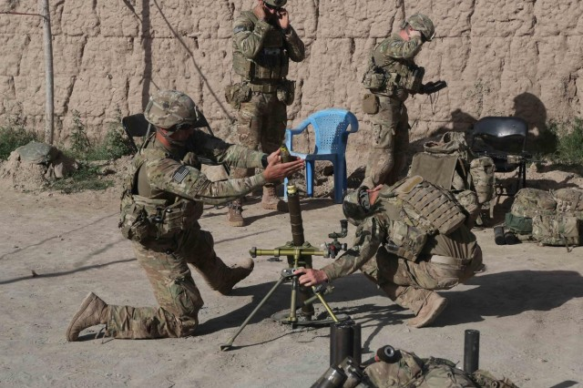 Spc. Andrew Landish and Spc. Tyrel Fisher, members of 2nd Platoon, Alpha Company, 1st Battalion, 327th Infantry Regiment, 1st Brigade Combat Team, 101st Airborne Division (Air Assault), prepare to launch a mortar strike from the village of Hesarak, Nangarhar Province, Afghanistan, May 15, 2013. Landish and Fisher communicated via radio with ground forces to coordinate precision fires on enemy forces.