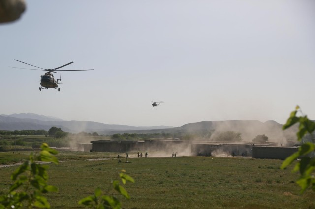 Afghan Air Force Mi-17 helicopters prepare to drop off supplies for Afghan forces outside the village of Hesarak, Nangarhar Province, Afghanistan, May 15, 2013.  The Afghan Air Force continues to increase their support role throughout the province.