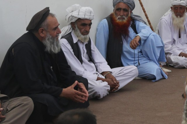 Afghan village elders gather at the local police station during a key leader engagement at Hesarak, Nangarhar Province, Afghanistan, May 17, 2013. The elders discuss what effect the presence of military forces in Hesarak has had.