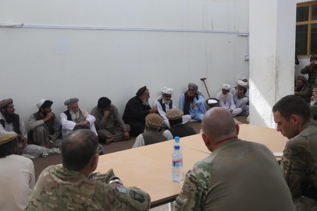 Afghan village elders gather at the local police station during a key leader engagement at Hesarak, Nangarhar Province, Afghanistan, May 17, 2013. The elders discuss what effect the presence of military forces in Hesarak has had. Soldiers from Alpha Company, 1st Battalion, 327th Infantry Regiment, 1st Brigade Combat Team, 101st Airborne Division (Air Assault), observed the engagement to help evaluate the situation in western Nangarhar Province, Afghanistan.