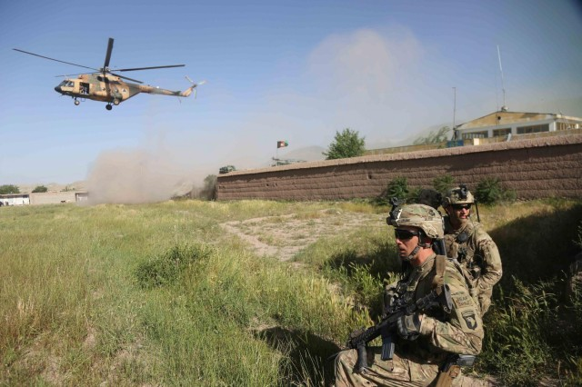 Soldiers from Alpha Company, 1st Battalion, 327th Infantry Regiment, 1st Brigade Combat Team, 101st Airborne Division (Air Assault), secure a landing zone for Afghan Air Force Mi-17 helicopters outside the village of Hesarak, Nangarhar Province, Afghanistan, May 17, 2013. The Mi-17s will transport Afghan National Army soldiers back to Forward Operating Base Connolly after a successful Afghan led clearing operation.