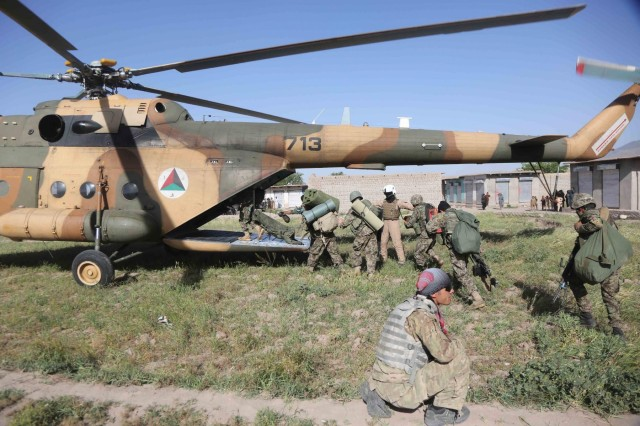 Afghan National Army soldiers from 1st Kandak, 4th Brigade, 201st Corps, climb into an Afghan Air Force Mi-17 helicopter for transport to Forward Operating Base Connolly after a successfully leading and executing a clearing operation near the village of Hesarak, Nangarhar Province, Afghanistan, May 17, 2013.