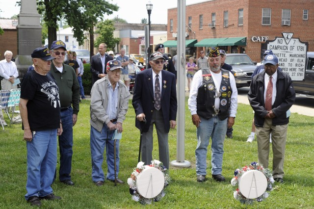 U.S. Army Garrison Fort A.P. Hill commander Lt. Col. Peter E. Dargle (center rear) joined local veterans in honoring the fallen during the Bowling Green, Va. Memorial Day observance.